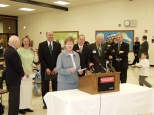 Mayor Hanneman (second to right of podium) at a Sun Prairie schools event. (Sun Prairie Star Photo)