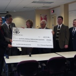 Mayor Hanneman (holding check at right) along with other Dane County mayors. (Sun Prairie Star Photo)