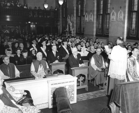 The windows are prominently visible in this newswire photo from 1946, from a Mass to celebrate presentation of a papal medal to Leo T. Crowley of Madison.