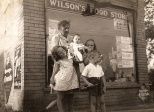 """Our newest """"Eye on the Past"""" feature photo shows a charming little grocery store located about 1.5 miles west of Lake Michigan in Waukegan, Illinois. Wilson's Food Store was located at 1814 Grand Avenue, operated by my Dad's aunt and uncle, Nina (Treutel) Wilson and Lawrence Wilson. Nina was a younger sister of my Grandmother Ruby (Treutel) Hanneman. Read more about it here: http://wp.me/p4FxQb-e0"""