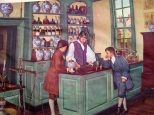 """Christopher Marshall, an Irish immigrant, established his apothecary shop in Philadelphia in 1729. During 96 years, this pioneer pharmaceutical enterprise became a leading retail store, nucleus of large-scale chemical manufacturing; a """"practical"""" training school for pharmacists; an important supply depot during the Revolution; and finally, it was managed by granddaughter Elizabeth, America's first woman pharmacist. Christopher earned the title of """"The fighting Quaker"""" during the Revolution; his sons, Charles and Christopher, Jr., (shown as youths with their father, about 1754) earned individual fame and carried on his fine traditions."""