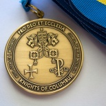 Knights in Racine, Wisconsin honor members of the Catholic church who provide exemplary service with the Pro Deo Et Ecclesia award. The medal was designed by Joe Hanneman.