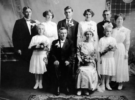 Groom Joseph Mras and bride Mary Sternot are flanked by flower girls Ruby V. Treutel (right) and Gladys Cole. Back row (left to right) includes Anton Sternot, unidentified woman, Joe Pyrch, Anna Sternot, John Sternot and another unidentified woman.