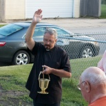 Father Mark Jones blesses the new home of the K of C in Racine, Wis., while Grand Knight Joe Hanneman (at right) looks on.