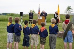 Boy Scouts participate in a flag retirement ceremony run by the Knights in Racine. Speaking at the podium is Deputy Grand Knight Joe Hanneman.