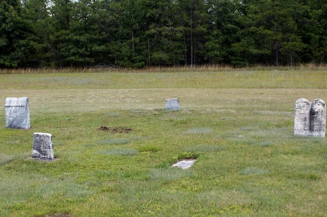 The grave site of Matthias Hanneman is at left center, indicated by the partially excavated stone.