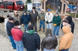 Knights and other Christian volunteers pray together after setting up a Nativity scene on Monument Square in Racine, Wis.