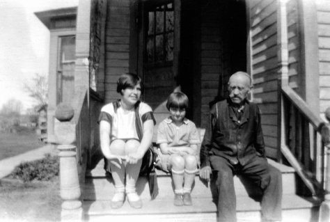 Nina and Elaine Treutel visit with Chas Hanneman, circa 1930.