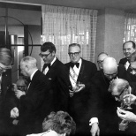 David D. Hanneman (left of center, dark hair), stands just behind his father, Carl, at the reception following the Knights of Columbus Fourth Degree exemplification.