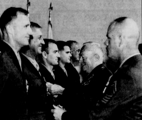 Maj. Joseph Small III (second from left) receives a medal at Bethesda Naval Medical Center in 1991.