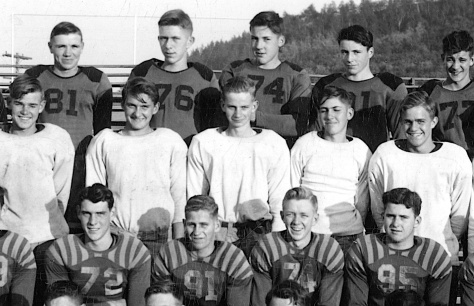 Almeron Freeman (farthest right in middle row), played for Mauston High School with David D. Hanneman (No. 72 in front row).