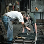 Pankratz and Olson prepare the form for the molten metal.