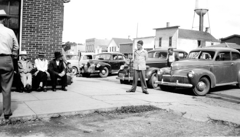 The uncropped version of the main photo shows David D. Hanneman in front of the Ortman Hotel in Canistota, South Dakota.