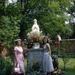Ruby Hanneman and daughter Lavonne before a statue of the Blessed Virgin Mary on the campus of Viterbo College.