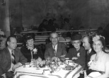 Ruby ( far right) with husband Carl (far left) at a dinner event in the 1940s.