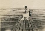 Ruby Treutel on a pier at Lake Michigan.