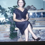 Ruby Hanneman seated next to the family home in Mauston, Wisconsin.