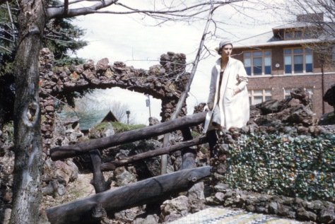 Lavonne Hanneman stands near an arch at the Rudolph Grotto Gardens in 1958 or 1959.