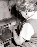 Irma Hanneman uses a grinding wheel to polish stones in 1966.