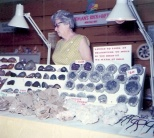 Irma Hanneman staffs the Hanneman Rock and Gift Shop display at a craft show.