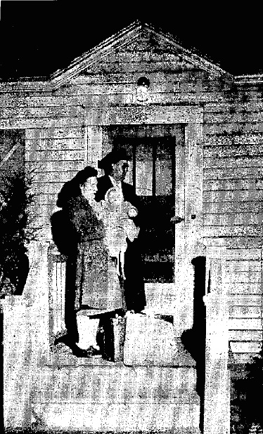 Charles, Margaret and baby Charles Victor Grinolds enter their new home at Mauston in 1946.