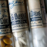 Drug vials from a portable pharmacy kit belonging to Carl F. Hanneman. Read more about that here: https://hannemanarchive.com/2013/07/11/portable-pharmacy-kit/