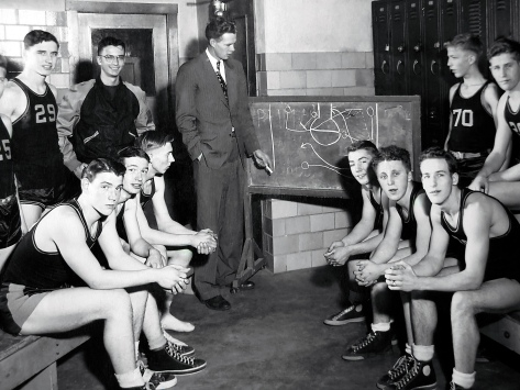 The 1948-49 Mauston junior varsity team, coached by Bob Erickson. Dave Hanneman is first on the bench at left.