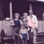 This Hanneman family vacation portrait was somewhat clumsily done, with colors spilling onto skin and other areas. At front and center is David D. Hanneman. In the back are Donn G. Hanneman, Ruby V. Hanneman, Carl F. Hanneman and baby Lavonne M. Hanneman. Photo circa 1940.