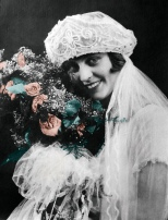 The roses in this bridal portrait of Ruby V. Hanneman were tinted. This digital restoration punched up the colors from the now-faded original from 1925.