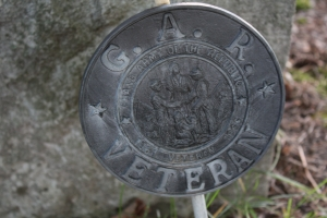 A Grand Army of the Republic medallion, posted in the Treutel family block at Union Cemetery, West Bend, Wisconsin.