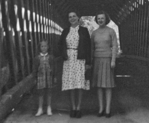 Nina Wilson (center) and daughter Laurni Lee (at left) on the famous covered bridge in 1941.