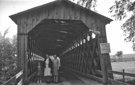 Nina (Treutel) Wilson (center) with daughter Laurni Lee (left) and an unidentified woman stand inside the covered bridge north of Cedarburg, Wis., on June 30, 1941.
