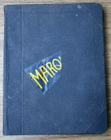 Two of the hardcover notebooks have remnants of Marquette pennants.