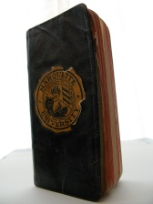 This 1916 pocket formulary book has the Marquette seal on the cover.