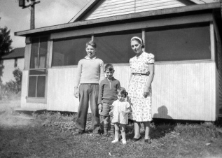 Donn G. Hanneman, David D. Hanneman, Lavonne Hanneman and their mother, Ruby V. Hanneman.