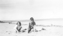 Lavonne and David Hanneman play on the shore of Lake Superior in Bayfield County, Wis., circa 1940.