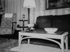 The corner of the painting is visible just above the couch at the Hanneman home in Mauston, shown here in the 1940s.