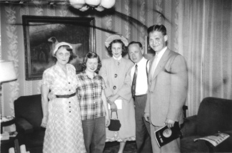 Ruby Hanneman, Ann Eckern, Elaine Hanneman, Carl Hanneman and Donn Hanneman in front of the painting in the Hannemans' Mauston home, circa 1948.