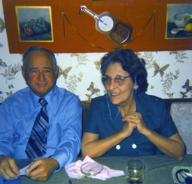 Carl and Ruby Hanneman at the kitchen table.