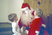 A neighbor plays Santa, apparently well enough to fool young David and cousin Laura. Yikes!