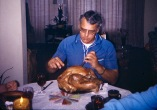 David D. Hanneman carves the Thanksgiving bird, circa 1974.