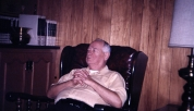 Carl F. Hanneman in the chair of honor, circa 1980.