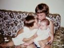 Laura Mulqueen holds her cousin, Amy Hanneman, while sister Marghi Hanneman delivers a smooch.