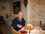 David Hanneman handles the time-honored duty of carving the Thanksgiving bird.