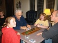 Abby and Samantha Hanneman watch Grandpa Dave play cribbage with son David.