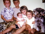 Laura Mulqueen holding cousin Amy Hanneman, circa 1969. The boys are Joe and David Hanneman. Marghi Hanneman and Heidi Ho-Ho Hanneman are at right.