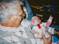 Stevie Hanneman explains the finer points of being a baby to Grandpa Dave.