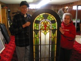 A frail Dave Hanneman and wife Mary with one of the stained glass sections donated to St. Mary's.