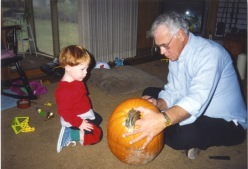 Grandpa Dave teaches Stevie how to carve pumpkins.