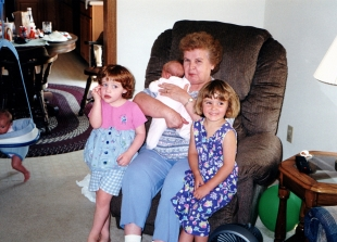 Grandma Mary holding new granddaughter Ruby, 1999. Samantha Hanneman is at left; Abby Hanneman is at right.